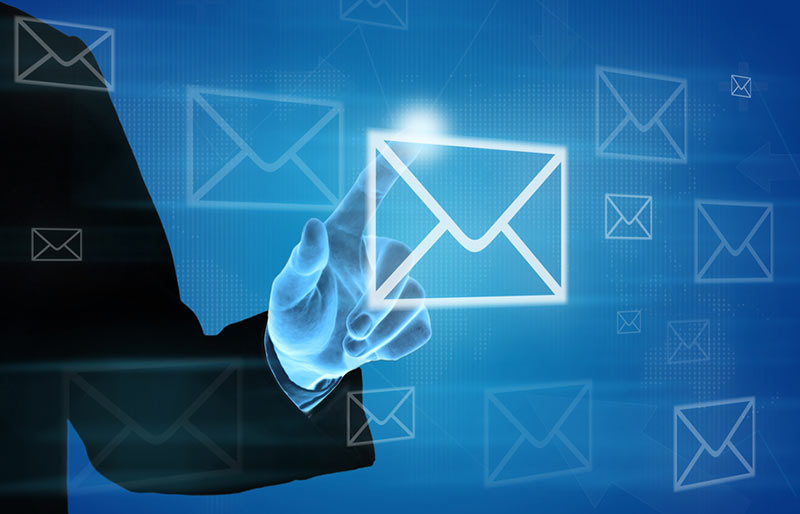 Businessman pushing e-mail icon on screen with finger.