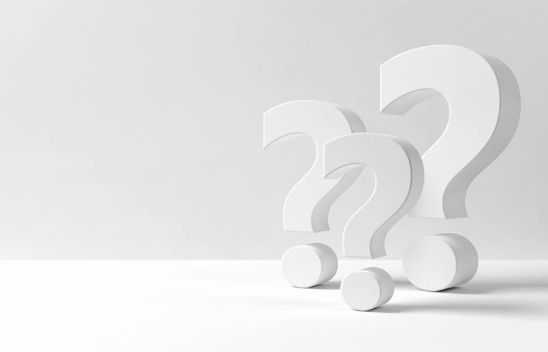 Three white question marks in a white background.
